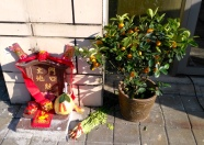 The little shrines before most shops also have fresh incense burning. Oranges symbolize luck.