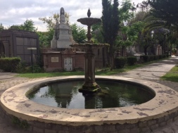 The cemetery is filled with statuary and fountains at the crossroads separating patios.